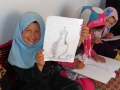 Paiting with the children at Bamyan cultural container