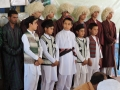 Students with traditional turkmen closthes in Afghani cultural day in Jawzjan